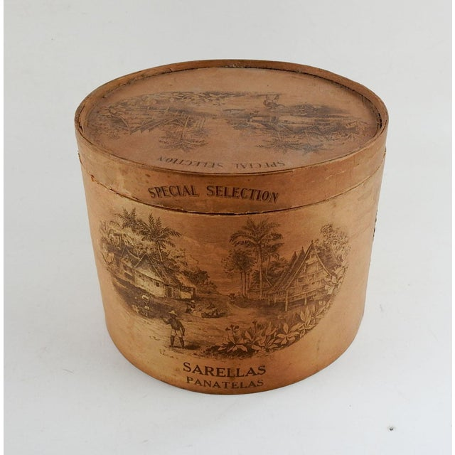 Vintage round wood cigar box, Sarellas, Panatelas. Box is thin wood with illustrations on paper applied to wood. Some wear...
