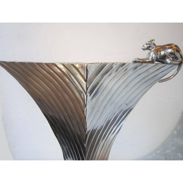 A huge, impressive and tall decorative vase with linear motif featuring a panther / animal sculpture perched at the...