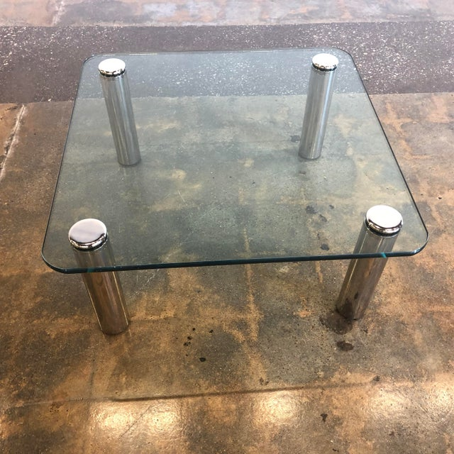 In excellent vintage condition with recently polished legs. The legs screw on through openings in the heavy glass top and...