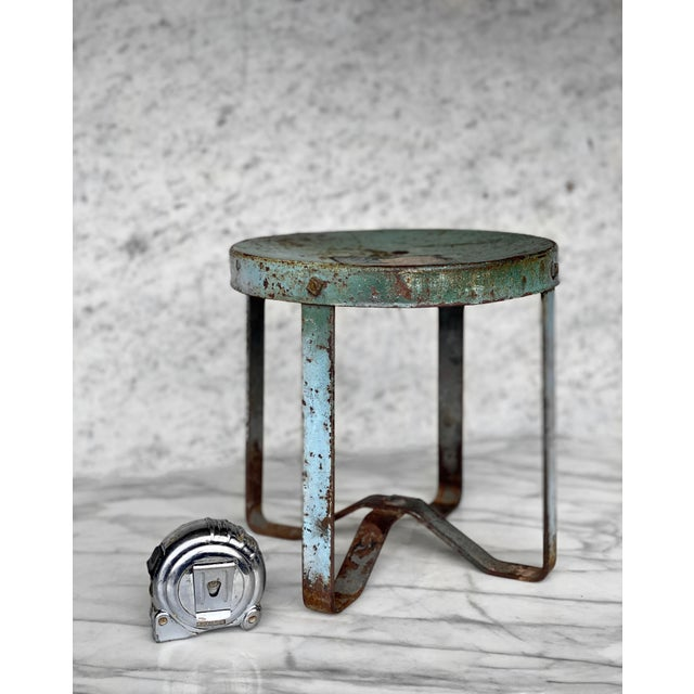A Farmhouse Aluminum Low Milking Stool, United States, c. Early 20th Century. This piece would look exceptional while on...