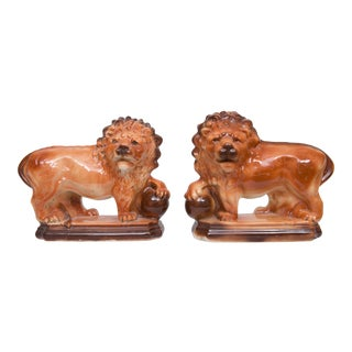 1900s Lancaster & Sons Ceramic Glazed Lions - A Pair For Sale
