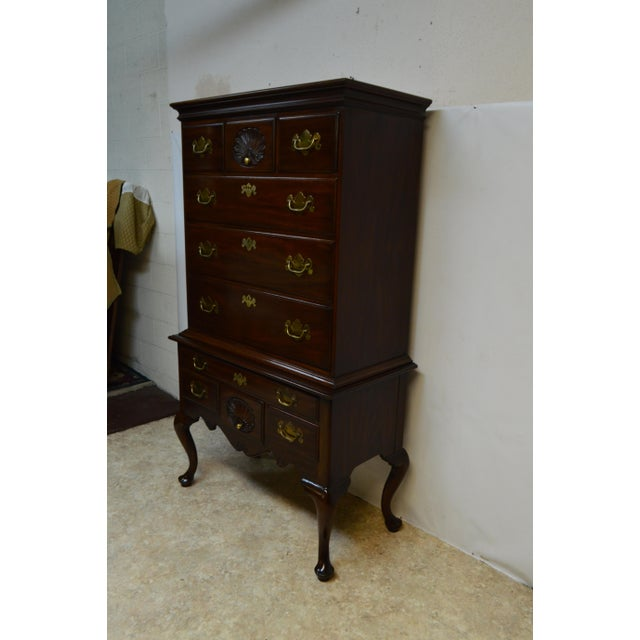 This is an antique Henkel Harris highboy chest that is comprised of 2 separate chests. The piece was crafted using solid...