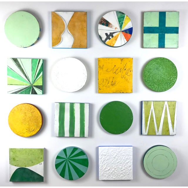 """Sixteen 8"""" cradled wood panels (round and square) make up this encaustic mixed media art piece. In the photo they are..."""