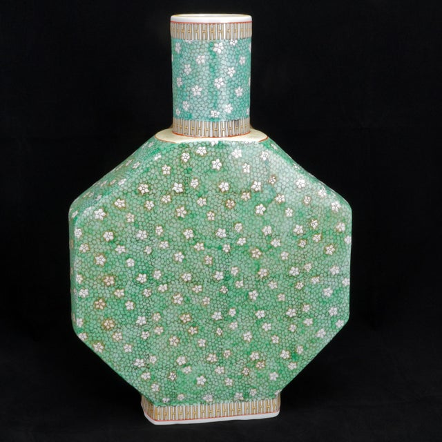 Large porcelain Chinese vase with an intricate hand painted design of crackled ice and a myriad of prunus flowers...