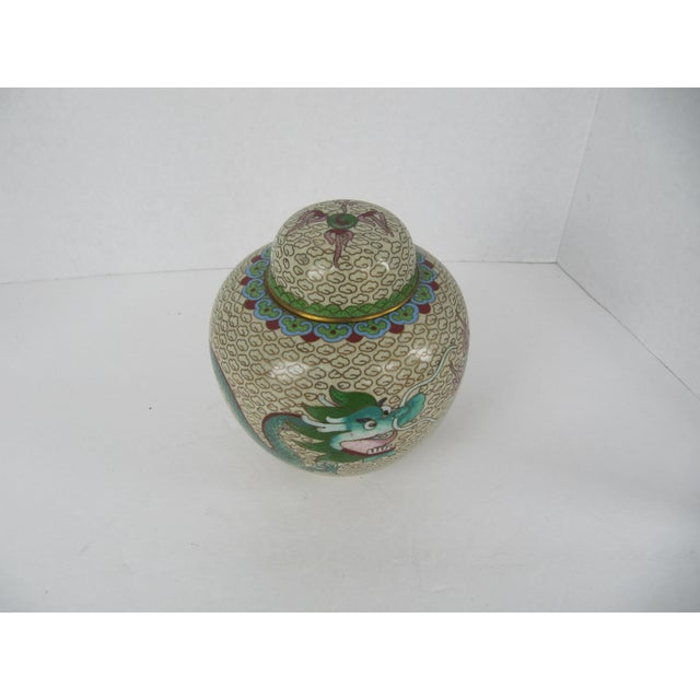 Pale yellow vintage cloisonné ginger jar with a two green dragons. Would look beautiful in any room.