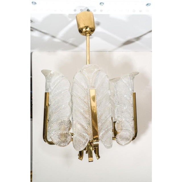 This stylish and chic six-light chandelier dates to the mid-20th century and was designed by Carl Fagerlund for Orrefors....