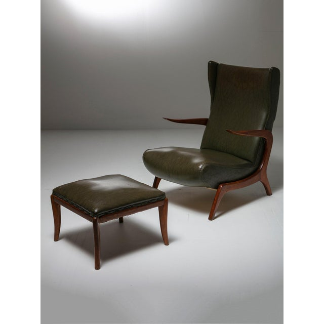 Pair of Italian 50s bergères with wood frame and one foot rest. Original artificial leather cover.