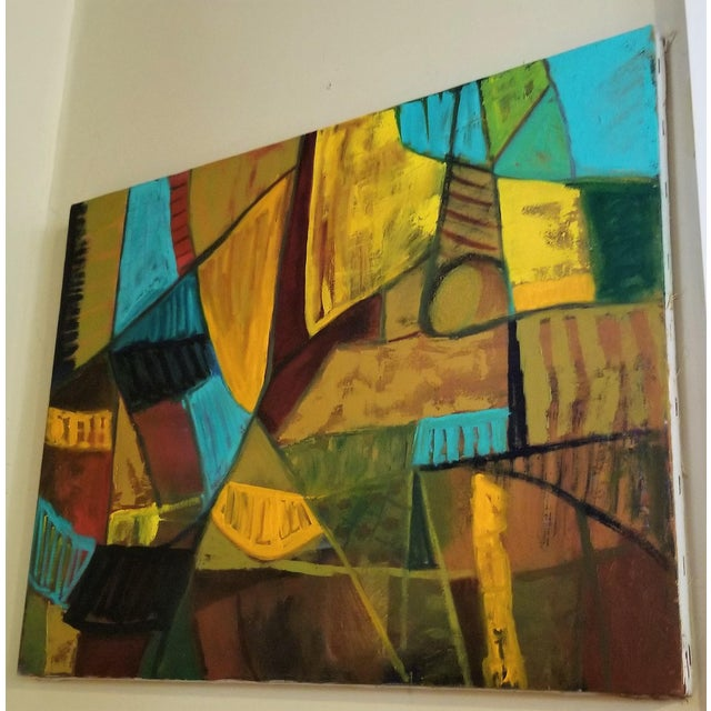 This is a Mid Century Modern painting with bright hues of Turquoise, Teal, Orange and Green. It is in excellent vintage...