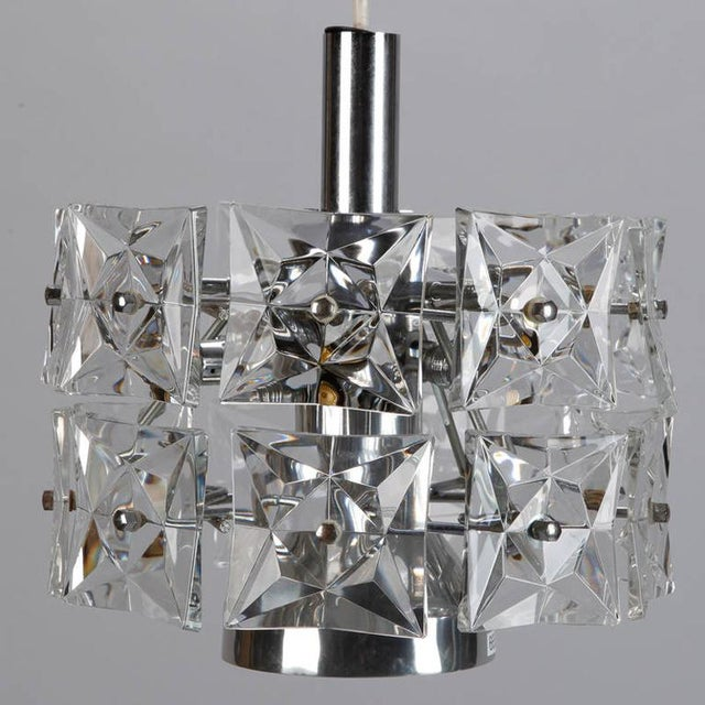 Circa 1970s hanging crystal fixture attributed to Austrian maker Kinkeldey has square faceted crystals and a chrome and...