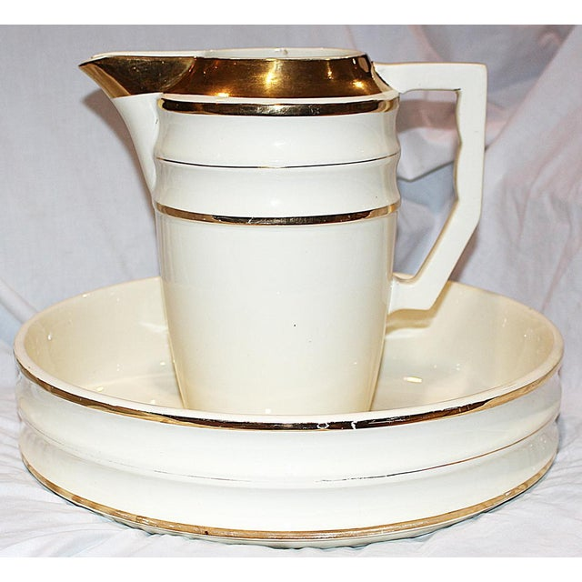 Here's a period Art Deco French pitcher and bowl by Terre de Fer with the French royal warrant, 'Choisy le Roi.' 23k gold...