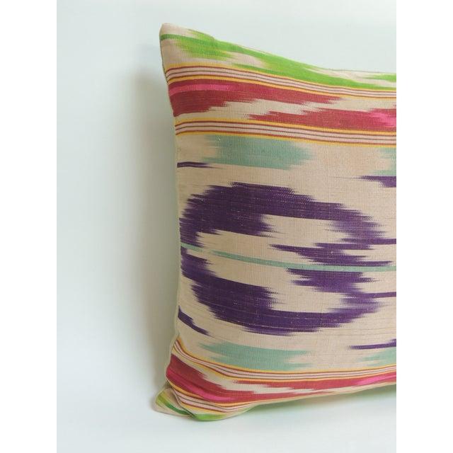 Antique colorful silk Ikat artisanal textile decorative lumbar pillow Silk Ikat textile bolster pillow in shades of...