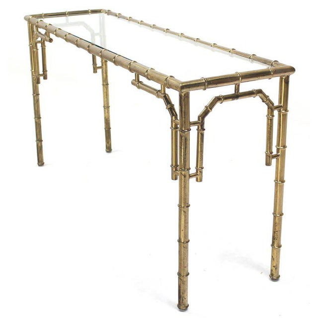 Very nice mid-century modern console table with some patinated areas in a few spots. In style of Maison Bagues