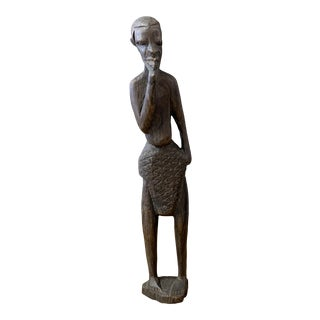Carved Wooden African Statue of Man on Stand For Sale