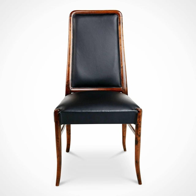 Expertly crafted set of four exotic jacaranda wood Brazilian chairs, circa 1970. These striking chairs are fabricated from...