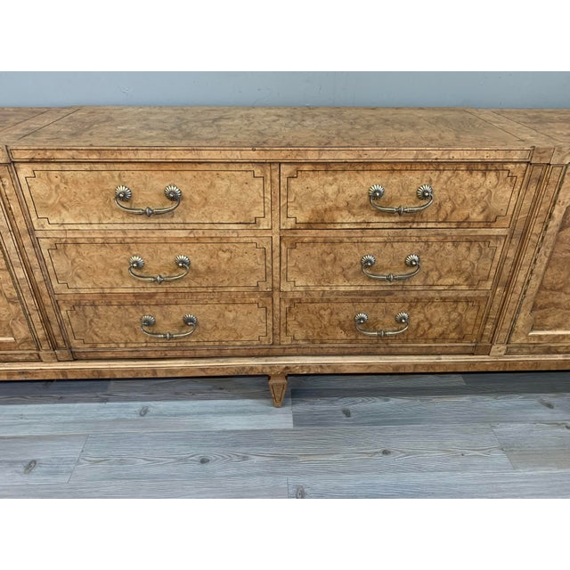 1970s Vintage Mastercraft Burled Wood Credenza. This beautiful Credenza has been completely refinished and has a large...