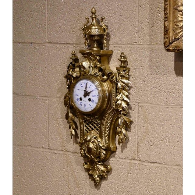 Crafted in Perpignan, southwest France, circa 1870, the wall clock made of bronze, features intricate decor in high...