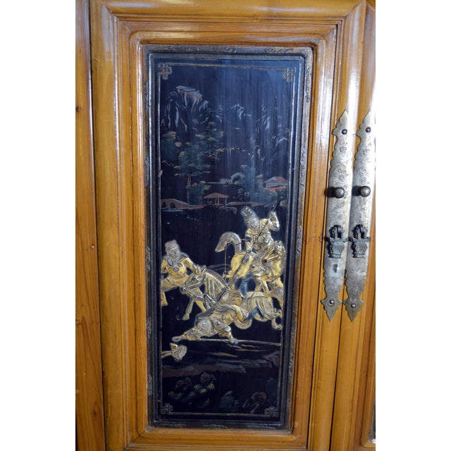 Early 20th Century Chinese Lacquered Armoire With Gilt Carved Warrior Motifs For Sale - Image 11 of 13