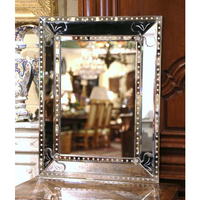 Decorate a powder room or a bedroom with this elegant, antique Venetian mirror from Italy. Crafted circa 1950 and...