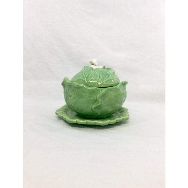 Green ceramic cabbage tureen with rabbits. Plate measures: 8.25''Dia x .75''H.