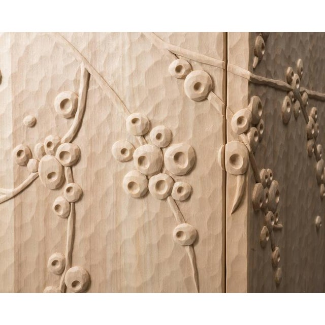 Hand-carved credenza in cottonwood with weathered brass pulls, Taos Blue interior, and clear finish. Custom sizes and...