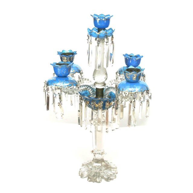 Pair of French Victorian Baccarat crystal and blue opaline five-arm candelabra with swirl design (1 bobesch repairs).