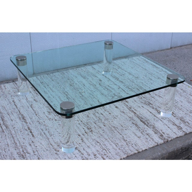 Fabulous thick lucite legs and nickel coffee table with 3/4'' glass top. The legs are 4'' diameter. In vintage original...
