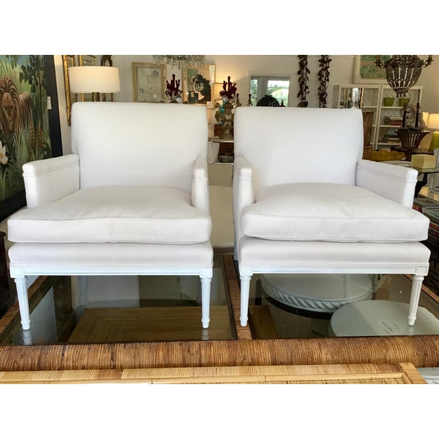 Fabulous Pair of French Louis XVI Club Chairs in New Sunbrella upholstery fabric and white finished frames. This pair...