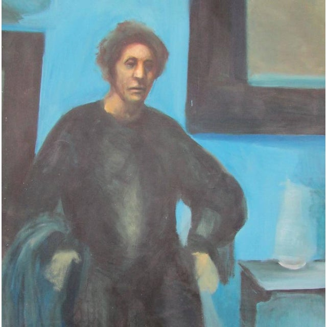 """This is a moody oil on canvas of a somber man standing in a blue room. """"Conrad Vogel NY"""" on verso; not dated."""