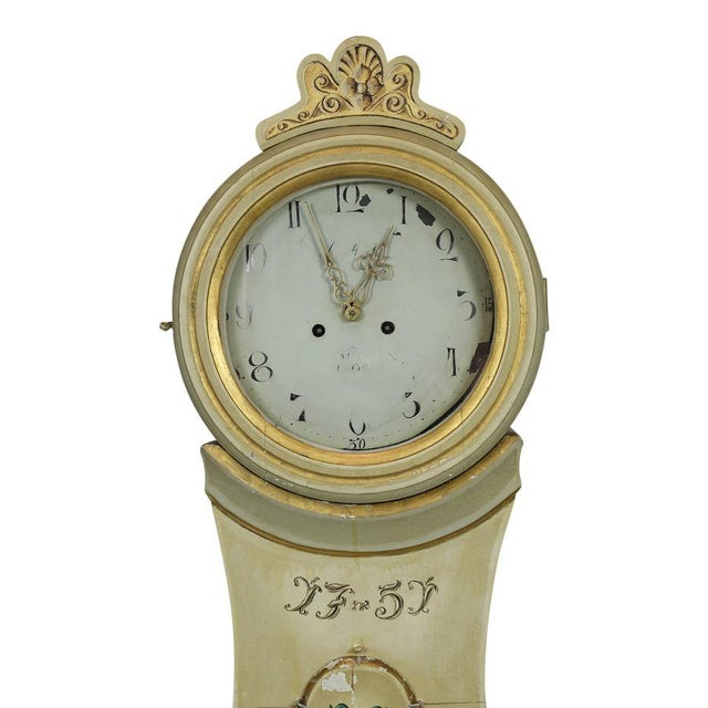 Antique Swedish Mora clock with the date 1751 hand painted onto the clock. This clock has delicate painted details to its...