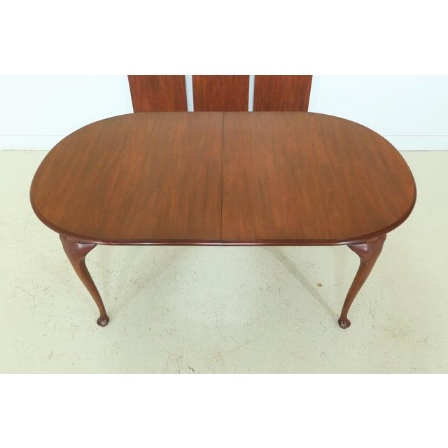Item: 49768EC: HENKEL HARRIS Oval Cherry Model 2206 Dining Room Table Age: C.2001 Details: Finish No. 24 Model 2206 High...