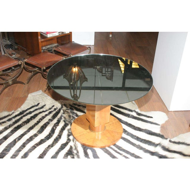 Jules Leleu (1883-1961). A modernist French Art Deco mirrored table, created circa 1936. In sycamore, with gilt bronze...