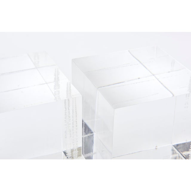 These lucite cube square clear bookends or display cubes are vintage from the 70's. They have multiple uses as also for...