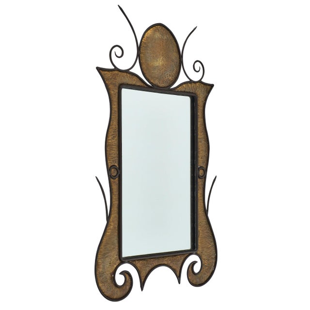 French Art Nouveau mirror made of embossed tin and iron. The texture of the soft golden colored tin with the black iron...