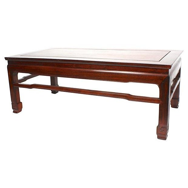 Antique 1940s Kang-style rectangular coffee table made of blackwood, a rare type of Chinese rosewood. Historically...