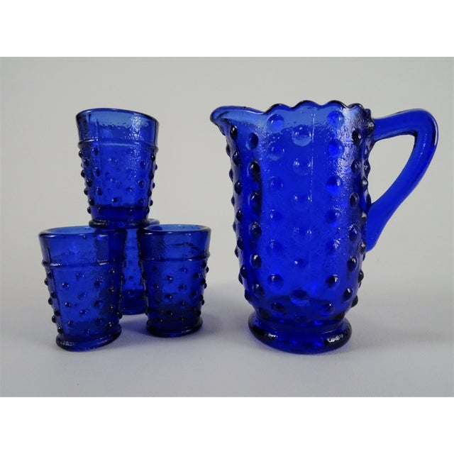 Sweet vintage miniature cobalt blue hobnail jug with 4 small cups. Glass is thick and sturdy. The pitcher measures...