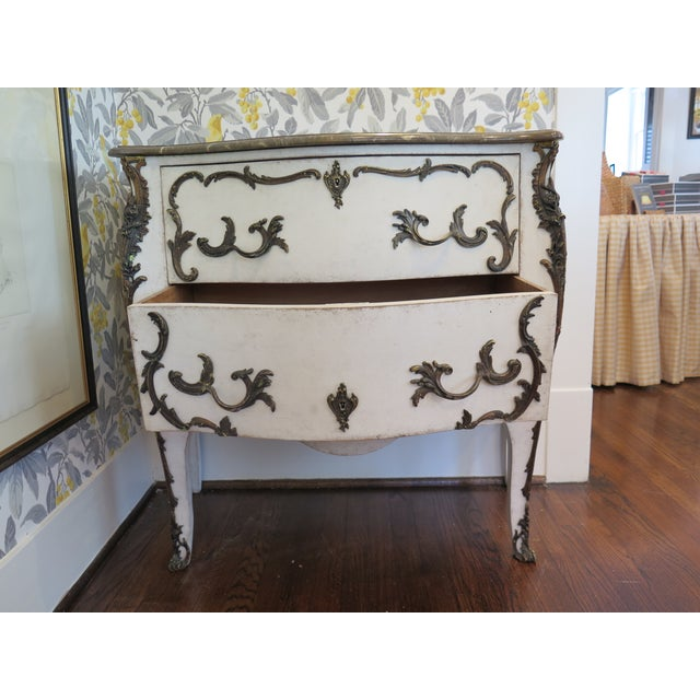 19th century Swedish Rococo commode with marble top and beautiful ormolu. Painted white.