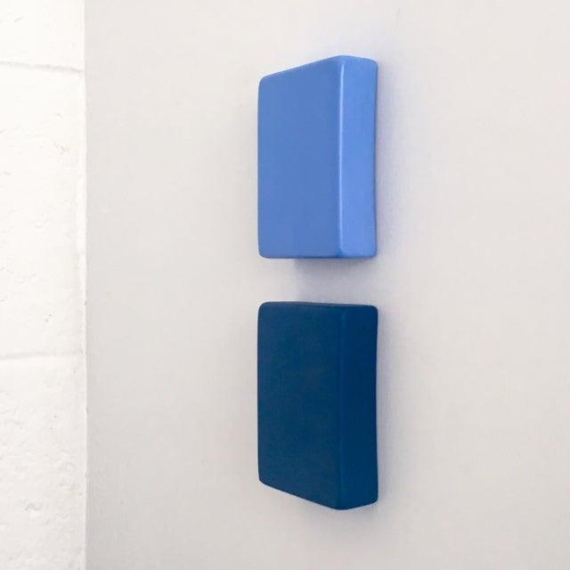 "Meditation of Blue Wall Sculpture X Elysia Vandenbussche YEAR: 2018 MADE: Detroit, MI DIM: 3""W x 3.75""H x .5""D 90"" H..."