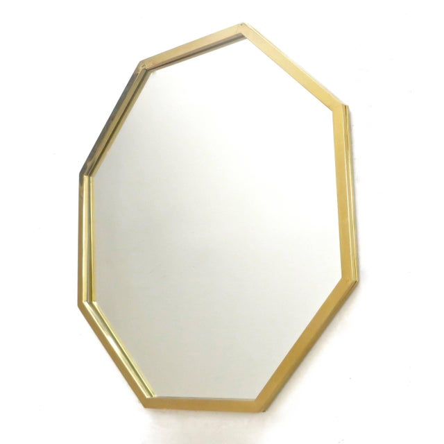 An octagonal brass framed Italian mirror with beautiful patina to the brass frame, circa 1940.
