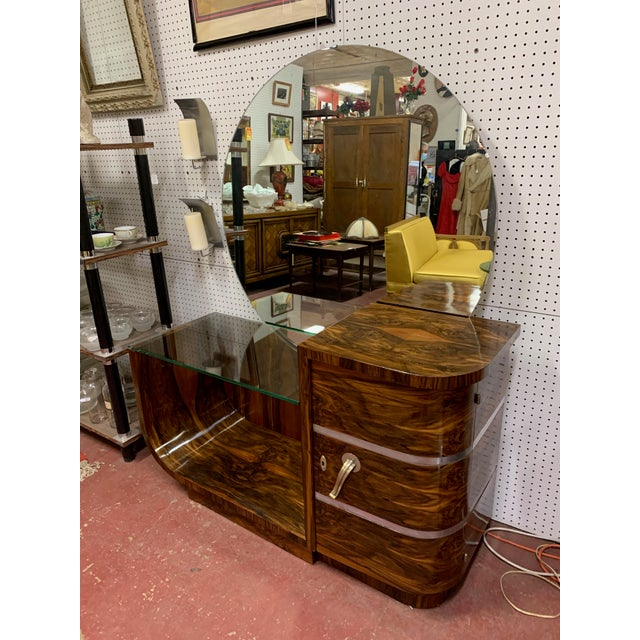 Large round mirror. Curved side on the left holds ½ inch thick glass top, to the center. Curved door on right side has...