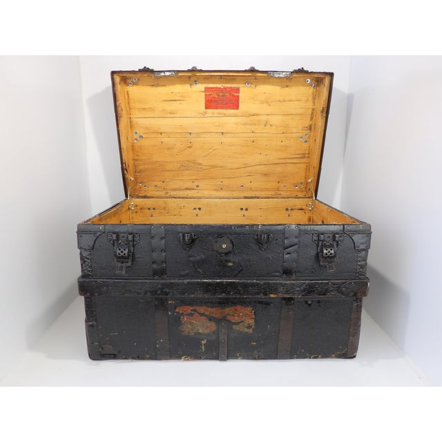 This is a an antique Crouch & Fitzgerald coffee table steamer trunk from the 1800s. The piece provides a beautiful space...