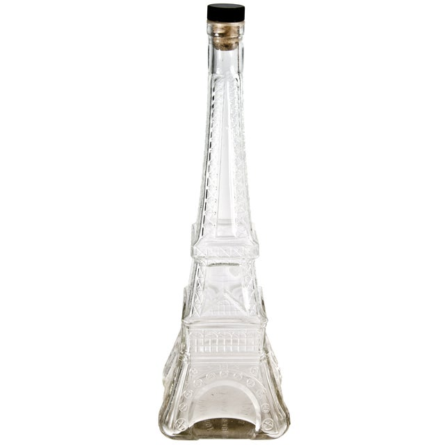 Vintage French glass liqueur bottle in the shape of the Eiffel Tower. Maker's mark on base.