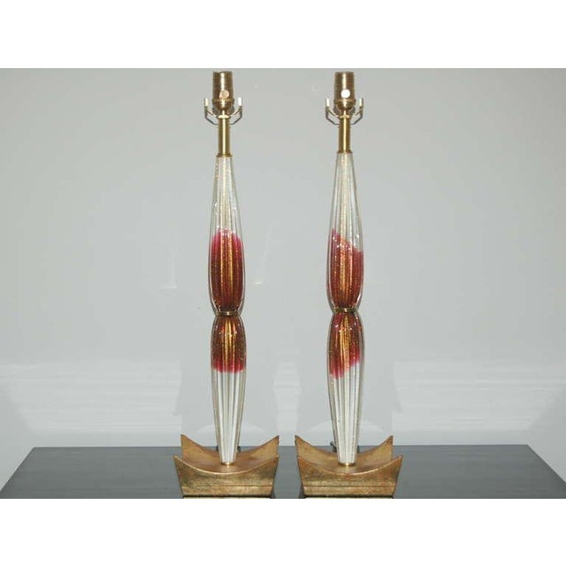 Stunning pair of vintage Venetian glass table lamps in CRANBERRY AND CREAM. Very rare and unique color pattern with loads...