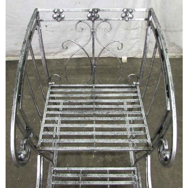 Wrought iron stand, formed into a sleigh with two shelves. Makes a terrific plant stand or other decorative piece.