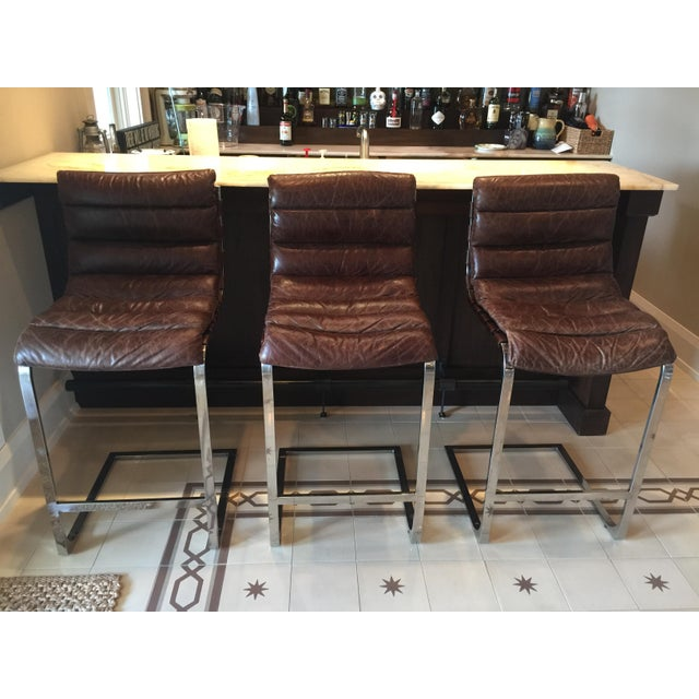 Restoration Hardware barstools, inspired by a classic 1960s midcentury silhouette. Leather is Vintage Cigar. Retail $1796...