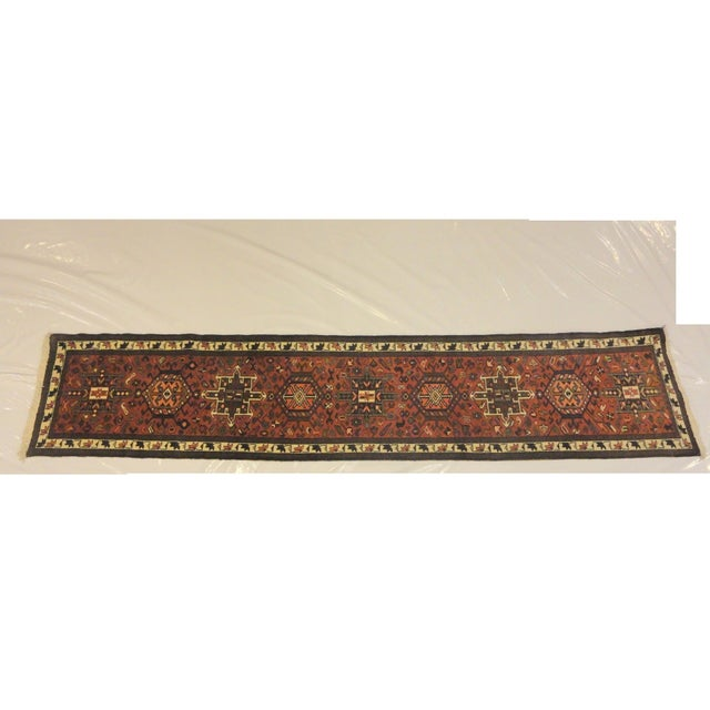 Add some ethnic elegance to your hallway with this semi-antique Persian Heriz runner rug. It was handmade in rich, vibrant...