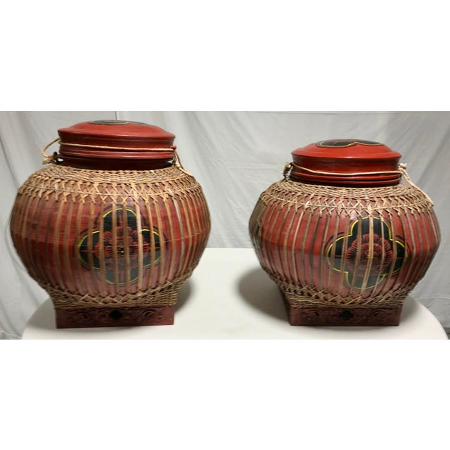 Pair of Asian, rattan storage containers. The containers are covered in what appears to be a paper mâché with a gloss...