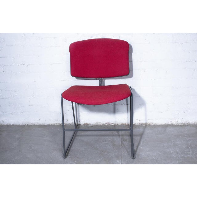 "It's the 1980s minimalist Steelcase ""stacking chair"" newly reupholstered in high quality red mico-linen. Works beautifully..."