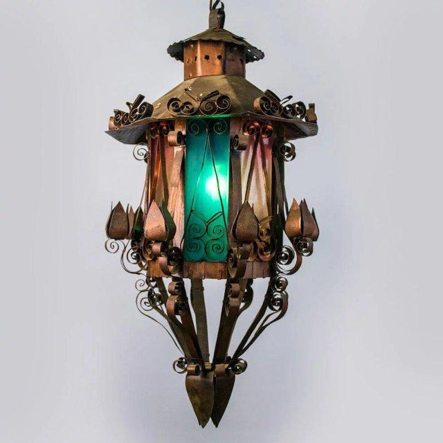 This mid century Spanish Revival lantern retains it's original copper finish and unusual rose and green colored glass. The...