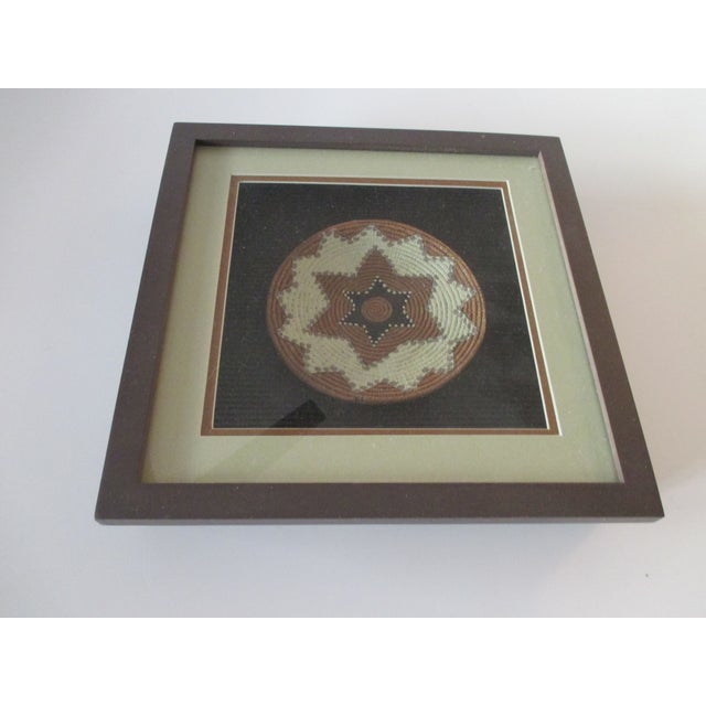 Vintage African Petite Basket Framed in a Shadow Box In shades of tan, brown and taupe Faux grass is ceramic. Size: 10 X...