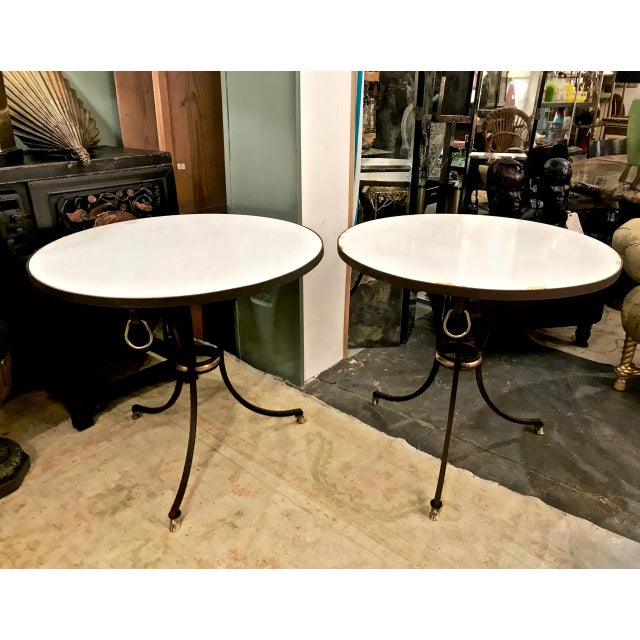 This is a great pair of classic c. 1970-1980 French wrought iron and Carrara marble gueridons. The gueridons are detailed...